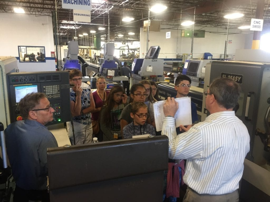Students hear about Swiss machining from Eric Smith at Pioneer Service Inc.